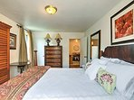 Wood furnishings fill the master bedroom.