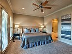 Unwind on the large king bed in the master.