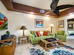 Living room has large ceiling fan