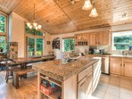 Large island in kitchen can seat up to 3 and provides a multifaceted working space