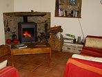 Cosy living room with woodburner for cooler evenings