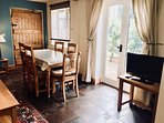 Dining area is open plan with views of the garden. The area has a TV/DVD player