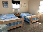 Two full size beds w/ flat screen TV and VHS Videos!