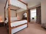 Double room enjoying a beautiful four-poster bed with estuary views