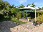 Seating area with BBQ and sunshades
