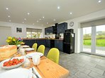 Spacious kitchen/diner with french doors leading to the garden
