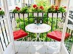 balcony overlooks quiet courtyard, ideal for alfresco dining
