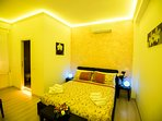 bedroom with chromotherapy with en-suite bathroom
