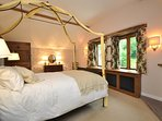 The four poster bedroom with stunning garden views