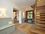 A spacious entrance hall with solid oak staircase
