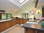 A stylish kitchen with woodland views