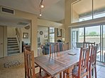 Enjoy home-cooked meals at the 6-person hardwood dining table.