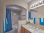 The first floor is furnished with a full bathroom hosting a shower/tub combo.