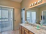 The full master bathroom boasts a shower/tub combo and balcony access.