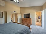 A 55-inch flat-screen TV and balcony complete the master bedroom paradise.