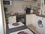 Kitchen (washing machine, sink, dishwasher, kettle, electric stove with oven, mini-bar, micro-wave)