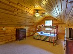 Upstairs is a loft with a twin-over-full bunk bed.