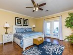 Gorgeous luxury master bedroom suite w/ private water view balcony.