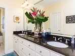 Master bath with granite counters and double vanity sinks. Large walk in closet.