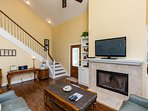 Large flat screen TV with cable TV. Wood burning fireplace.Stereo system. Movie