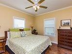 Main level guest room with comfy king bed and tommy bahama decor.