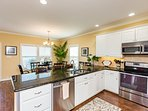 Beautiful kitchen cabinetry and stainless steel appliances.  Kitchen fully stocked