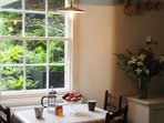 The outlook from the kitchenette includes unusual ferns, sedges, grasses