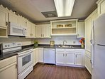 The lower level also offers a fully equipped kitchen for your convenience.