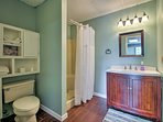The finished basement boasts a full bathroom with a walk-in shower.