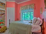 Bright colors, toys and a twin bed make this a great bedroom for a child.