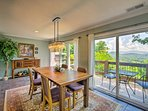 The dining room has a 4-person hardwood table and breathtaking views.