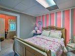 The connected room hosting a queen bed is the only way to get to the twin bed.