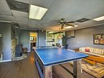 A game room boasts a ping pong table, slot machines and a flat-screen Smart TV.