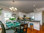 View of dining area and granite counter with seating for 12 with extra barstools