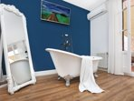 Ensuite master bedroom with vintage bath overlooking the terrace