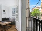 Living room's balcony facing a quiet and charming street