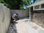 Steps leading to the outdoor shower. New gas and charcoal grill included
