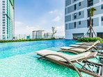 Swimming pool right next to a garden is an ideal place to catch some fresh air and relax