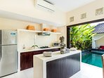 Fully equipped kitchen facing to the pool area