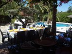 Gardens and pool with seating area for 14 people and 10 sun loungers