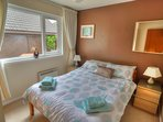 Lovely bright double bedroom with fitted wardrobe. Overlooks picnic area and B.B.Q