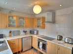 Lovely bright modern kitchen with tiled floor and large fridge/freezer for all your holiday needs