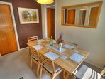 Dining area with large mirror and picture of Aviemore area