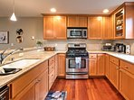 Cook with stainless steel appliances in the fully equipped kitchen.