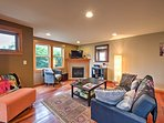 The window-lined living room has ample natural sunlight.