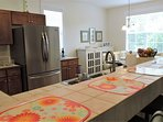 The kitchen and dining area provides a bright and cheery atmosphere.