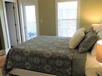 The second bedroom also provides access to the second floor screened porch.