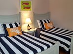 The third bedroom is furnished with two twin beds and has an en suite bathroom.