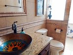 Lovely glass bowl sink & granite vanity