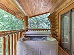 This vacation rental cabin features a private hot tub!